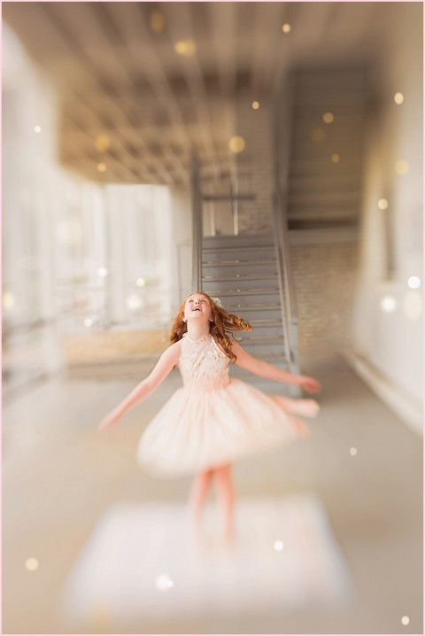 Young girl makes a wish and twirls in a sparkling dress in this magical photo by Ristaino Photography of Sarasota FL