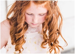 Little girl with red hair and freckles looks down during Operation Love Lola Beauty Revived Session by Ristaino Photography of Sarasota Florida