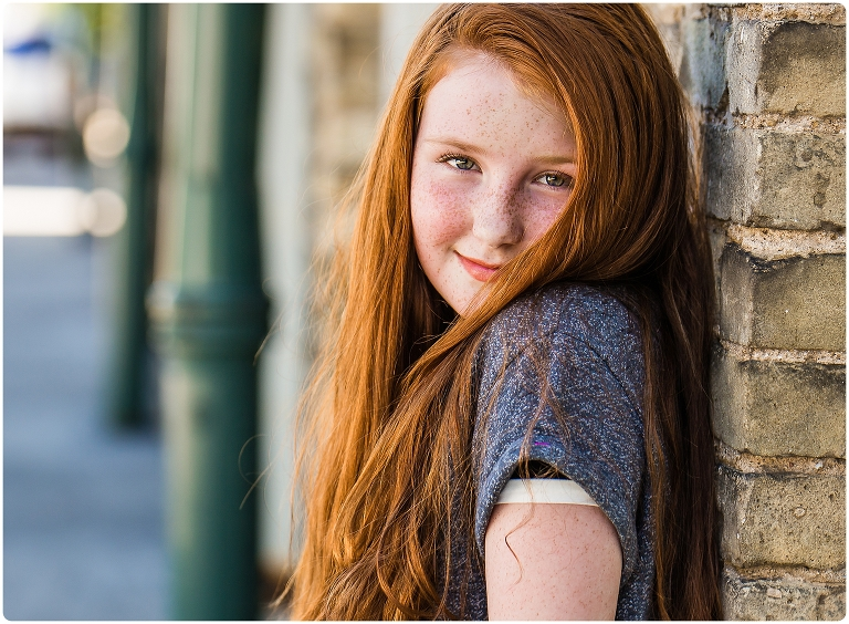 Tween girl with red hair and freckles has photoshoot every year for 3 years.