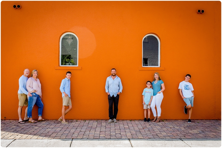 family photo in front of orange wall in historic burns court sarasota